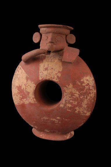 Vase annulaire à goulot céphalomorphe