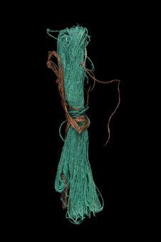 Metier à tisser : écheveau de fils verts