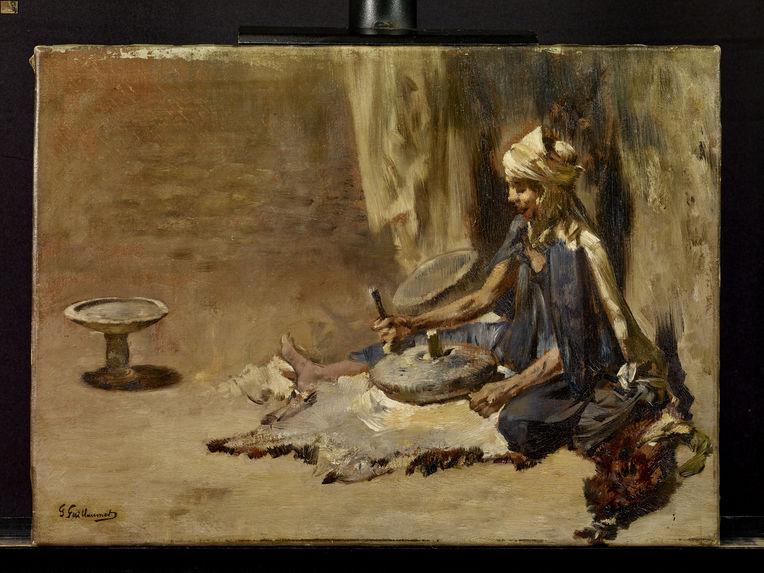 Femme arabe préparant le couscous