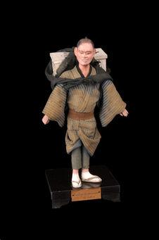 Figurine représentant un employé de commerce