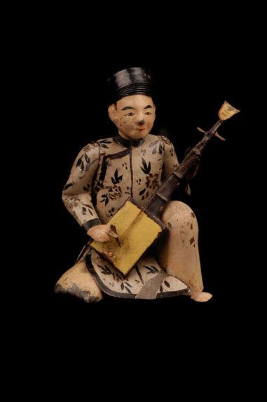 Jouet représentant un musicien