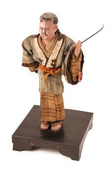 Figurine représentant un gardeur d'enfants