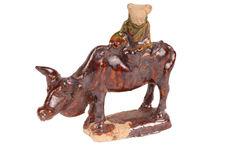 Figurine représentant un personnage sur un buffle