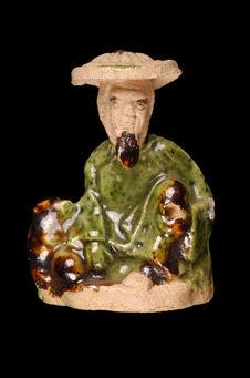 Figurine représentant un pêcheur