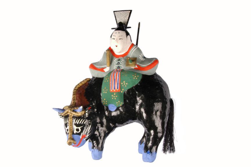 Figurine représentant Tenjin monté sur un buffle