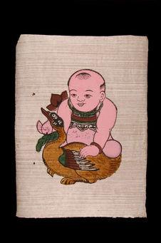 Image populaire : jeune enfant tenant un canard avec fleur de lotus