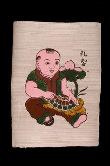 Image populaire : jeune enfant tenant dans ses bras une tortue