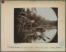Fleuve Moesi avec une maison malaise flottante