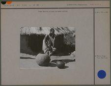 Femme Basouto et pots de bière kaffir