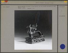Grattoir-masseur en bronze orné d'un paon