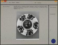 Assiette plate en céramique vernissée