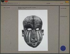 Masque en bois peint en noir et blanc