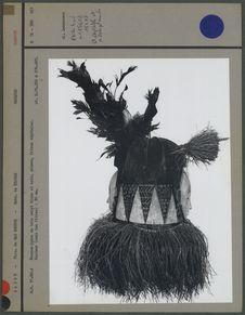 Masque-janus en bois peint blanc et noir