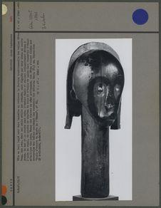 Tête en bois laqué noir
