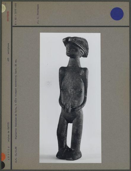 Statuette féminine en bois, tête formant couvercle