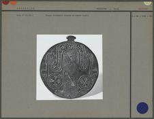 Plaque circulaire en bronze ciselé