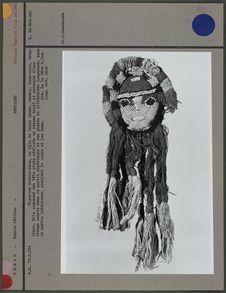 Figurine double-face en fils de laine
