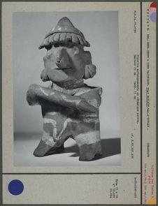 Figurine debout en céramique peinte