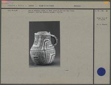 Pot en céramique grise, au décor peint