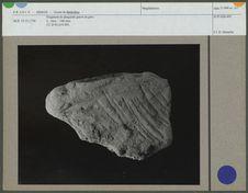 Fragment de plaquette gravé en grès