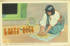 Tesuque woman making rain gods, pueblo of Tesuque, New Mexico