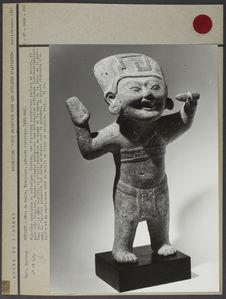 Figurine souriante en céramique creuse