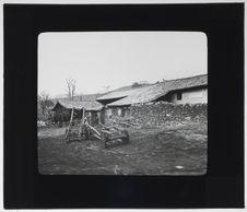 Maison et chars chinois à Sia-Long-T'an