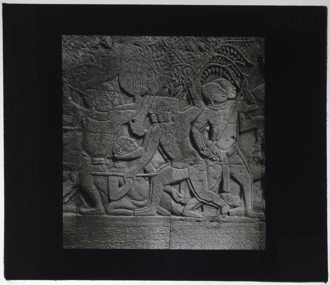 Bas-relief du Bayon. Récolte du fiel sur les blessés
